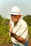 7908086-angry-farmer-standing-in-farm-field-with-a-pitchfork.jpg